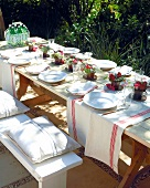 Table laid for special occasion out of doors