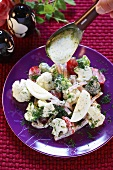 Cauliflower, broccoli and egg salad with herb dressing