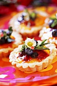 Fruit tart with strawberry flower