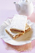 Pieces of apple cake dusted with icing sugar