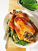 Roast turkey with mushroom risotto stuffing