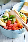Melon and pineapple salad with mint leaves