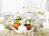 Floral decoration and eggs on Easter table