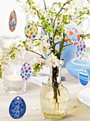 Blossom branches and egg hangers on Easter table