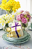 Easter gift and flowers on laid table