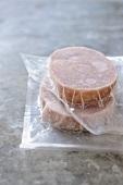Frozen tuna fillets in plastic packaging