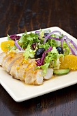 Chicken breast with salad leaves and orange segments