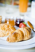 Croissant and jam for breakfast (France)