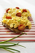 Scrambled egg and cocktail tomatoes on toast