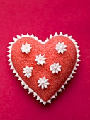 Red sugar heart with white flowers