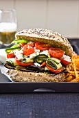 Bread roll filled with aubergine, courgettes, tomatoes and feta