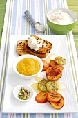 Barbecued fruit, mango sauce and coconut ice cream on toast