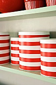 Striped containers on shelf