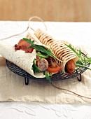 Pork sausage wraps with fruit relish