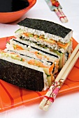 Sushi sandwiches with salmon and vegetable filling