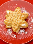 Star-shaped pancakes with icing sugar