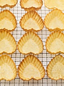 Heart-shaped pastry shells on cake rack