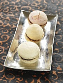 Three macarons with chocolate filling
