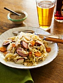 Cabbage with kielbasa, mustard sauce, beer (Poland)