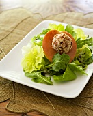 Salad leaves with pear and nut-coated goat's cheese ball