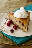 Pear and vanilla cake with cream and cranberries