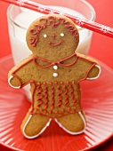 Gingerbread man in front of glass of milk
