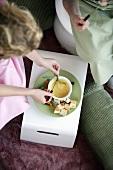 Children eating cheese fondue