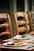 Place-setting on rustic table on terrace