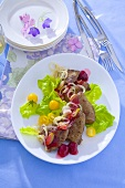 Calf's liver with onions, raspberry dressing and cherry tomatoes