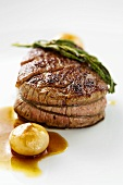 Roast fillet of beef with pickled onions
