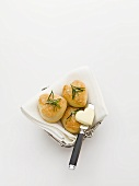 Heart-shaped pastries with rosemary and butter