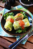 Cabbage leaves with mince stuffing and tomato sauce