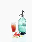Watermelon drink and a soda syphon