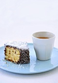 Lamington (Australian sponge cake) with teacup