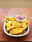 Deep-fried sweet potato slices with ketchup