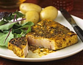 Fish steak marinated with herbs