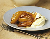 Tipsy pear wedges with vanilla syrup and clotted cream