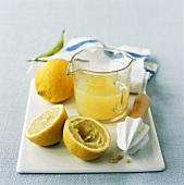 Lemons, lemon squeezer and lemon juice