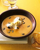 Pumpkin soup with whipped cream and pumpkin seeds