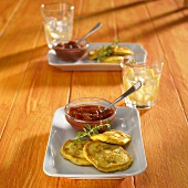 Pumpkin blinis with chili dip