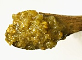 Green curry paste on a spoon