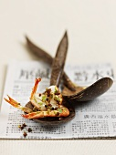 Peppered shrimp on a wooden spoon