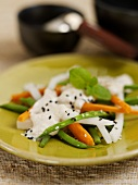 Vegetables with tofu dressing and sesame seeds