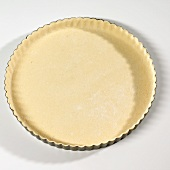 Tart tin lined with pastry