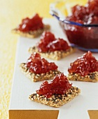 Redcurrant and apple jam on wholemeal crackers
