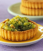 Kiwi fruit, apple and walnut jam in a flan case