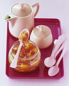 Rhubarb and orange jam on a spoon