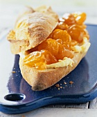 Grapefruit and kumquat marmalade on a bread roll