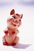 Grinning rubber pig