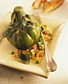 Cooked artichoke with vegetable accompaniments